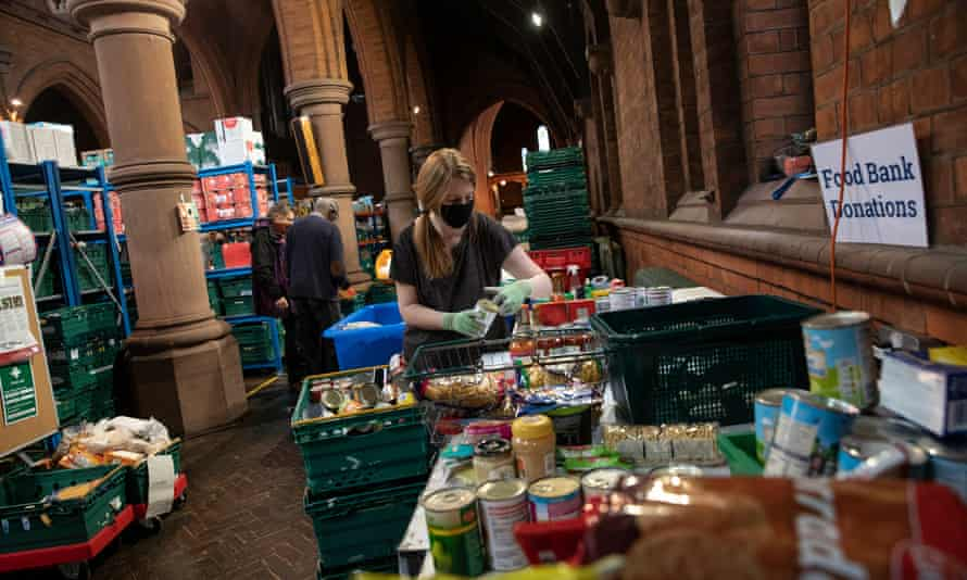 Staff and volunteers pack food parcels at the Norwood and Brixton food bank distribution centre at St Margaret's Church on October 27, 2020 in London