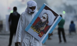 A Bahraini protester carries a picture of the Saudi Shia cleric executed in early January.