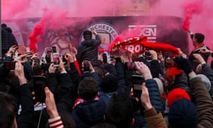 Liverpool supporters react to the Manchester City team bus