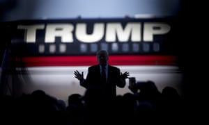 Donald Trump is silhouetted against his plane as he speaks during a campaign stop in Bentonville, Arkansas, in 2016. He also put his name on the ill-fated Trump Shuttle's aircraft.