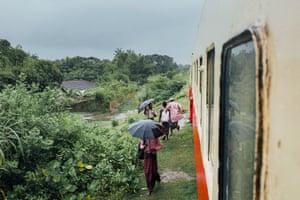 Rohingyas get off the train near a Rohingya village on the Sittwe-Zaw Pu Gyar line