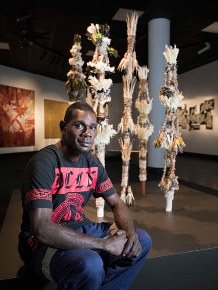 The winner of the emerging artists award, Matthew Dhamuliya Gurriwiwi, with his work Banumbirr (Morning Star).