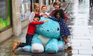 Children get to grips with an oversized Scruff-a-Luv