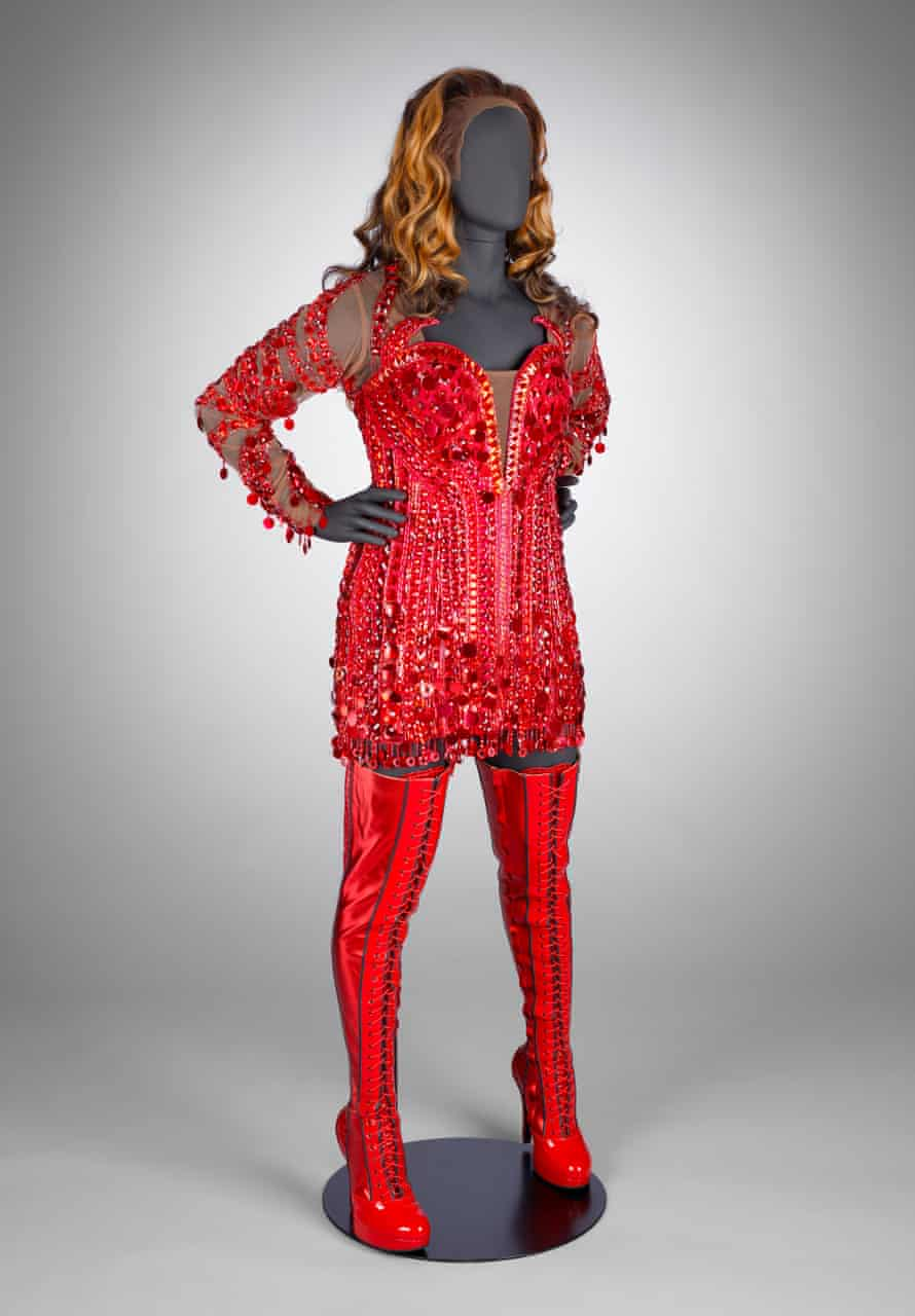 Red dress and thigh-high boots worn by Lola the drag queen in Kinky Boots.