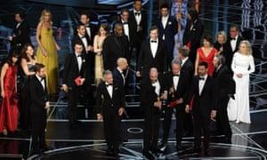 Jordan Horowitz (front, centre) announces the actual best picture winner – Moonlight.