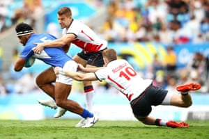 Neria Fomai of Samoa is tackled by Tom Mitchell and Ruaridh McConnochie of England during their rugby sevens match. England won 33-0.