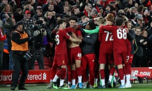Liverpool players celebrate with Curtis Jones (second left) after he scored the winning penalty.