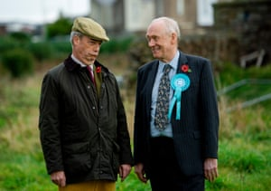 Nigel Farage (L) meets local Brexit PArty candidate David Walker. Britons go to the polls on 12 December in a general election.