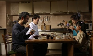 a still from koji fukadas harmonium with the four main characters sitting at the kitchen table