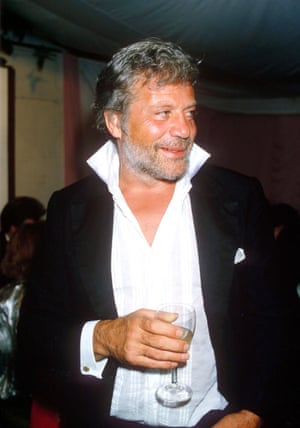 Oliver Reed, glass in hand, in 1985