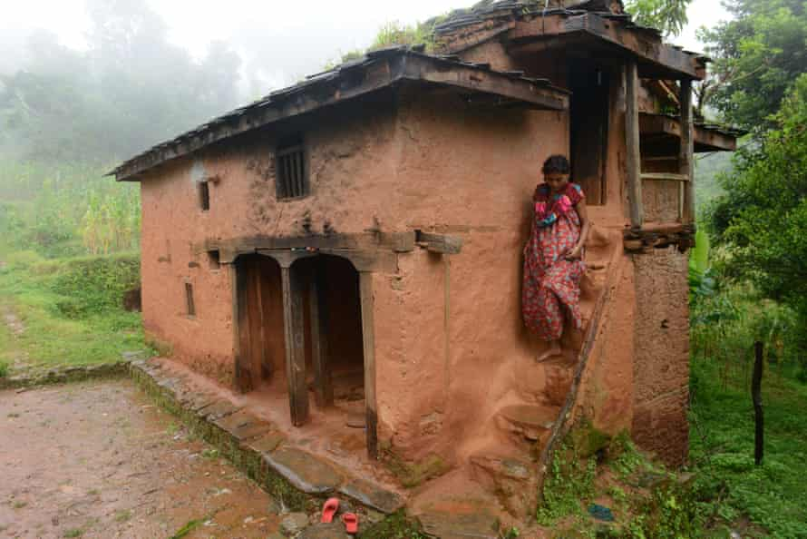 Maysara Hamal descends the stairs at her home to meet a Nepalese community health volunteer