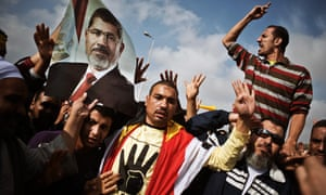 Egyptian supporters of the Muslim Brotherhood protest outside the trial of ousted president Mohamed Morsi in Cairo in 2013.