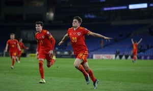 Wales' Daniel James (centre) celebrates scoring the opening goal.