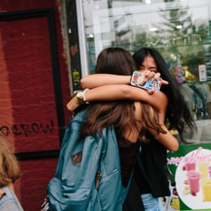 Two girls hug each in New York City.
