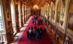 The Commonwealth leaders walk through St George's hall during a summit retreat at Windsor Castle.