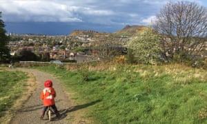 Lucie Tinsdale's son rides his bicycle in Edinburgh.