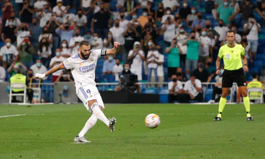 Karim Benzema scores Real Madrid's fifth goal from the penalty spot to complete his hat-trick.