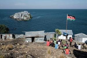 A Kenyan flag flies at the base of Kenyan marine police station on Usingo island, which overlooks Migingo island