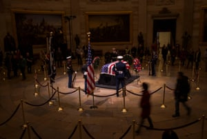 The former US president George HW Bush lies in state in Washington DC, US