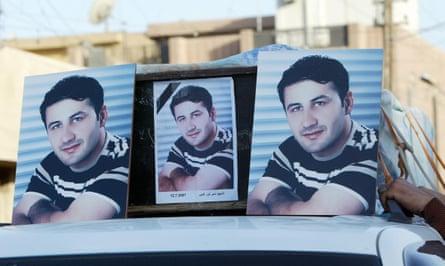 Pictures of Namir Noor-Eldeen atop his coffin