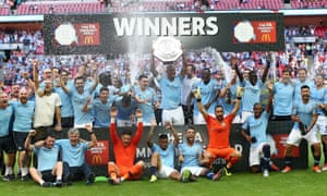 City celebrate with the shield.