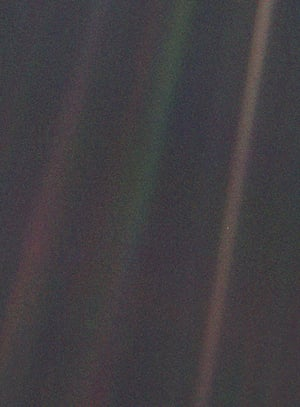 """14 February 1990 – Often referred to as """"the pale blue dot"""" image, this picture was taken when Voyager 1 was 4bn miles (6.4bn km) from Earth and 32 degrees above the ecliptic plane"""