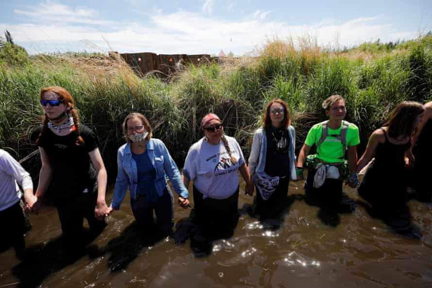 Indigenous leaders and activists participate in a prayer at the Mississippi headwaters on the third day of a protest of the Line 3 pipeline.