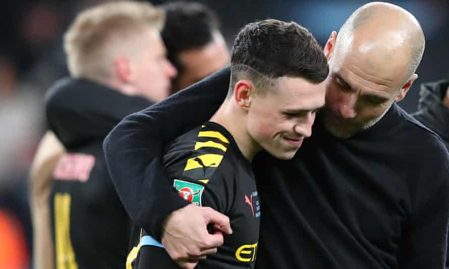 Pep Guardiola (right) celebrates with Phil Foden