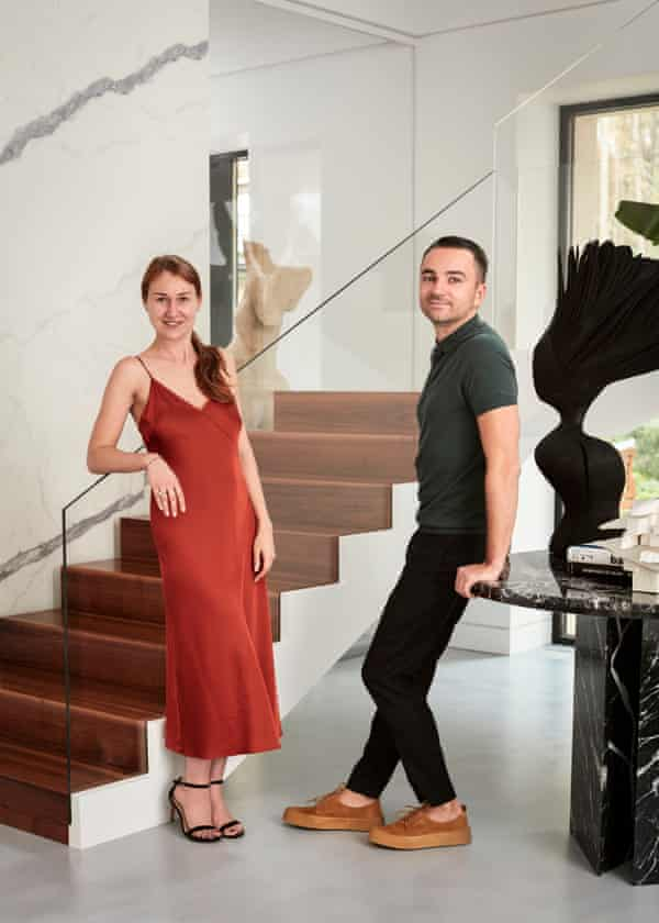 Anastasia Blagodarnaya and Alexander Kozlov by their zigzagging modern staircase.