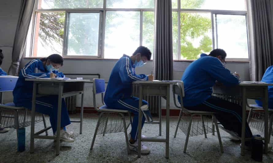 Students participate into a simulated National College Entrance Examination at a middle school to prepare for the gaokao
