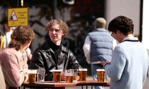 People are seen enjoying drinks in outdoor beer gardens on April 12, 2021 in Manchester, England.