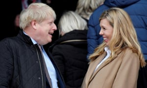 Boris Johnson with Carrie Symonds just before the England v Wales match begins at Twickenham on 7 March.