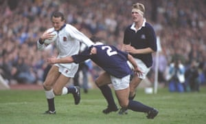 John Webb tries to hold off the tackle of Scotland's John Allen during the World Cup semi-final at Murrayfield in Edinburgh.