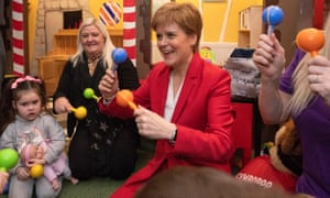 Nicola Sturgeon plays with local children during a visit to the Jelly Tots & Cookies Play Cafe in Uddingston, South Lanarkshire