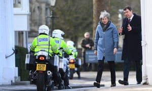 Police officers on duty as Theresa May visited Salisbury yesterday.