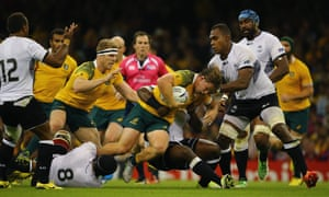 Michael Hooper drives on during the Wallabies' 2015 World Cup match against Fiji in Cardiff. Australia will open their 2019 World Cup against Fiji