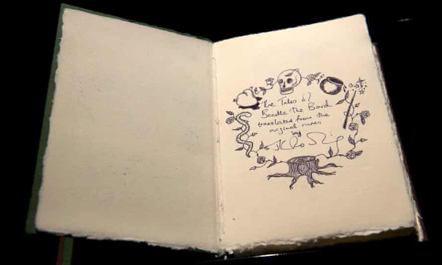 One of only seven copies of a handwritten and illustrated book by British author J.K. Rowling titled The Tales of Beedle the Bard is on show at Sotheby's auction house in London on December 9, 2016. / AFP PHOTO / Justin TALLISJUSTIN TALLIS/AFP/Getty Images