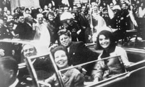 John F Kennedy and his wife Jacqueline in the motorcade in Dallas shortly before the president was assassinated in November 1963.