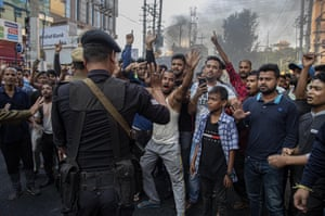 A commando attempts to quell demonstrators in Guwahati, India