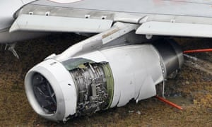 An engine of an Asiana Airlines plane sits damaged at Hiroshima airport.