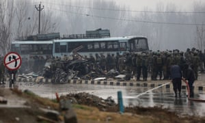 Indian security forces inspect the blast site in south Kashmir's Pulwama district