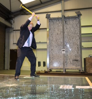 Boris Johnson uses a sledge hammer to test safety glass, during a visit to Windell Ltd, in Magherafelt, Londonderry.
