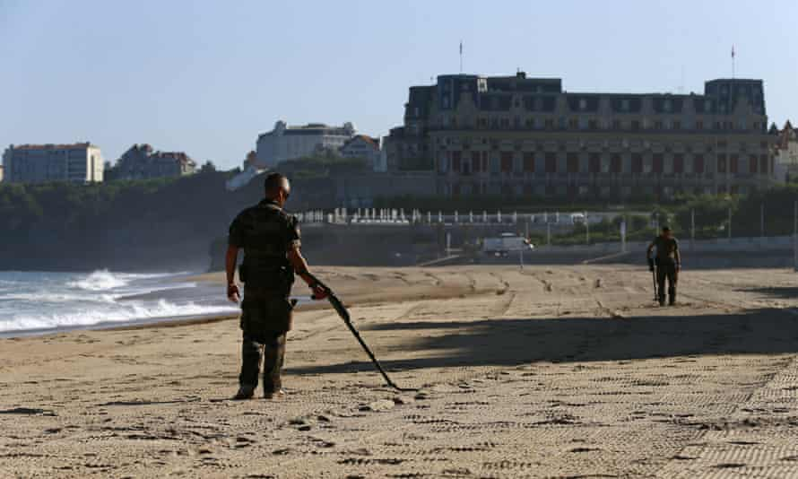The French military sweeps for potential mines along the beach
