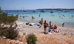 People relaxing on the beach and swimming at Ile Sainte Marguerite