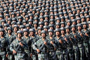 Soldiers of China's People's Liberation Army at the military parade to commemorate the 90th anniversary of the foundation of the army at Zhurihe military training base in Inner Mongolia, China.