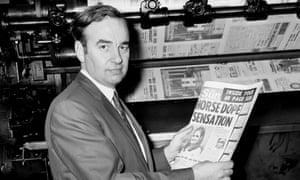 Rupert Murdoch in 1969, looking at one of the first copies of the new tabloid Sun.