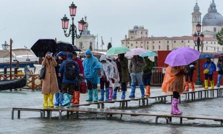 Tourists in Venice during the record acqua alta of November 2019