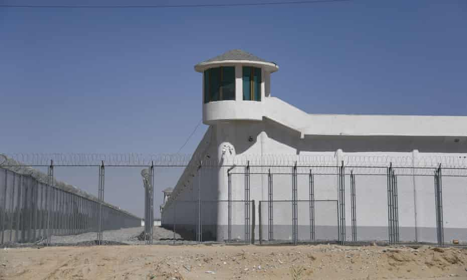 A camera is mounted on a watchtower at a high-security facility in Xinjiang, China, believed to be a re-education camp where Uyghurs are detained.
