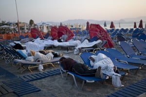 Kos, Greece: Hundreds of residents and tourists sleep outdoors on beach loungers and cars a night after a powerful earthquake across the Aegean Sea region
