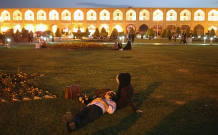 A young couple lies in the Unesco-listed Naqsh-eJanan Square in Isfahan, Iran.